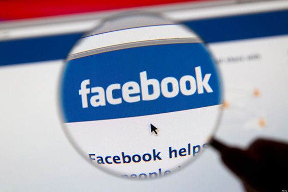 Facebook website page with Facebook logo and magnifying glass.. Image shot 2011. Exact date unknown.