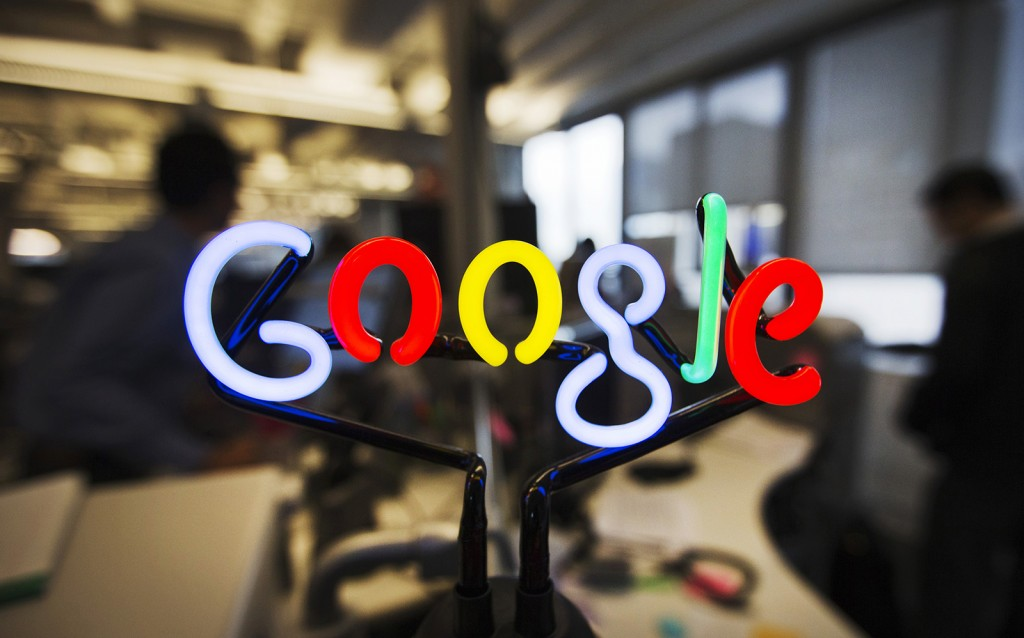 A neon Google logo is seen at the new Google office in Toronto
