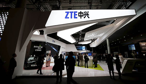 File photo of visitors attending the ZTE stand at the Mobile World Congress in Barcelona